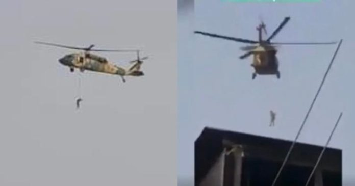 Taliban Fly Black Hawk Helicopter With A Body Hanging
